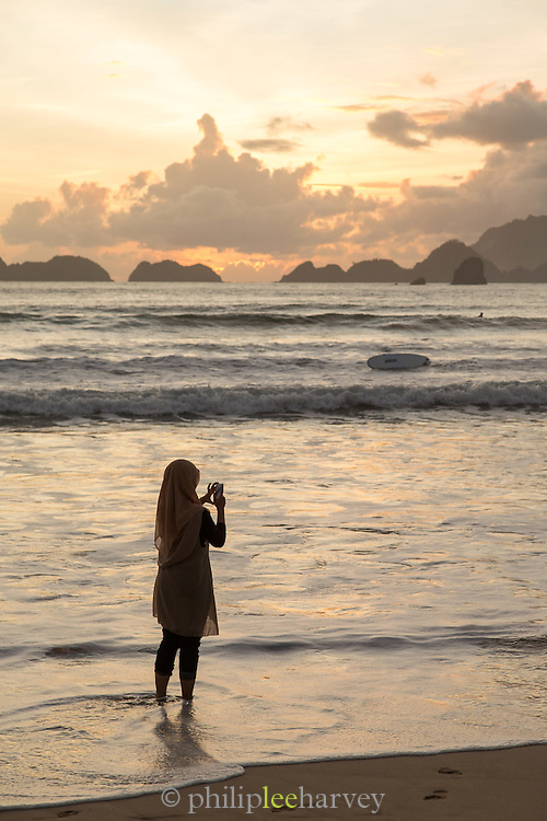 Woman taking photograph, Red Island Beach, Red Island, Banyuwangi Regency, East Java, Indonesia, Southeast Asia