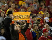 Nov 18, 2011; Ames, IA, USA; An Oklahoma State Cowboys fan holds a sign during the first half of a game against the Iowa State Cyclones at Jack Trice Stadium. Iowa State Cyclones defeated the Oklahoma State Cowboys 37-31. Mandatory Credit: Beth Hall-US PRESSWIRE Editorial sports photography of the Iowa State Cyclones vs. Oklahoma State Cowboys in 2011 in Aimes, Iowa.