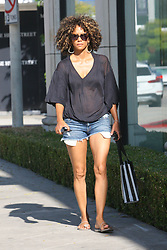 EXCLUSIVE: Halle Berry wearing see through shirt and demin short while shopping on melrose ave in west hollywood. 12 Aug 2017 Pictured: Halle Berry. Photo credit: MEGA TheMegaAgency.com +1 888 505 6342
