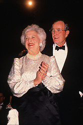 United States President-elect George H.W. Bush and his wife, Barbara Bush attend a dinner at the Corcoran Gallery of Art in Washington, D.C. on January 18, 1989.<br /> Credit: Brad Markel / Pool via CNP /ABACAPRESS.COM  | 463144_001 Washington Etats-Unis United States