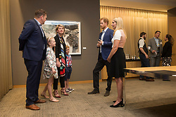 Prince Harry chats with Australian veteran Mark Reidy, left, Reidy's wife Karen May, centre left, and moderator Bronwen Evans during a reception before attending the True Patriot Love Symposium, in Toronto on Friday, September 22, 2017. Photo by Chris Young/The Canadian Press/ABACAPRESS.COM
