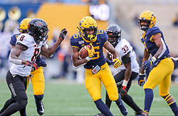 Nov 23, 2019; Morgantown, WV, USA; West Virginia Mountaineers wide receiver George Campbell (15) runs for extra yards after a catch and is tackled by Oklahoma State Cowboys cornerback Rodarius Williams (8) during the third quarter at Mountaineer Field at Milan Puskar Stadium. Mandatory Credit: Ben Queen-USA TODAY Sports