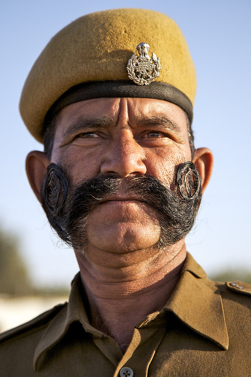 Indian police man from Jaipur, Rajasthan. The idea of elaborate moustache into distinct, facial features, began in India around the time of the Rajputs, the former Hindu military ruling class.