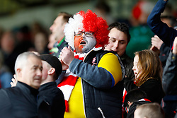 """A Lincoln City fan in the stands prior to the Emirates FA Cup, Fifth Round match at Turf Moor, Burnley. PRESS ASSOCIATION Photo. Picture date: Saturday February 18, 2017. See PA story SOCCER Burnley. Photo credit should read: Martin Rickett/PA Wire. RESTRICTIONS: EDITORIAL USE ONLY No use with unauthorised audio, video, data, fixture lists, club/league logos or """"live"""" services. Online in-match use limited to 75 images, no video emulation. No use in betting, games or single club/league/player publications."""