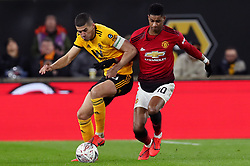 Wolverhampton Wanderers' Conor Coady (left) and Manchester United's Marcus Rashford battle for the ball during the FA Cup quarter final match at Molineux, Wolverhampton.