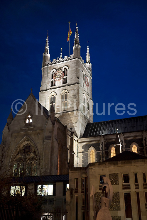 Southwark Cathedral at night, London. Southwark Cathedral or The Cathedral and Collegiate Church of St Saviour and St Mary Overie, Southwark, London, lies on the south bank of the River Thames close to London Bridge.It is the mother church of the Anglican Diocese of Southwark. It has been a place of Christian worship for over 1,000 years, but a cathedral only since 1905. The present building is mainly Gothic, from 1220 to 1420.