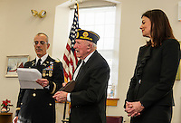 Lt. Col. Roy Hunter and Senator Kelly Ayotte present Pvt 1st Class Rosario Cadorette with two Bronze Stars and a Purple Heart medal for his service to our country in World War II at a presentation in his honor with the American Legion Post at the Belmont Mill on Wednesday afternoon.  (Karen Bobotas/for the Laconia Daily Sun)