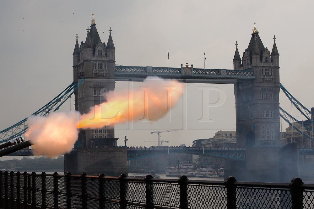 © Licensed to London News Pictures. 21/04/2014. London, UK. A 62 Gun Salute is fired by members of the Honourable Artillery Company (HAC) in honour of Her Majesty the Queen's 88th birthday today, 21st April 2014 at the Tower of London in front of Tower Bridge in London.. Photo credit : Vickie Flores/LNP