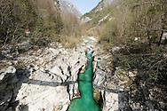 Hiking beside the River Soca on the Alpe Adria Trail, Triglav national park, Slovenia. The Alpe Adria Trail (AAT) is a 750km hiking route through Austria, Slovenia and Italy. © Rudolf Abraham