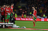 Gareth Bale of Wales jumps in the air with delight as he celebrates after the match as the Wales team qualify for Euro 2016 finals in France.  Wales v Andorra, Euro 2016 qualifying match at the Cardiff city stadium  in Cardiff, South Wales  on Tuesday 13th October 2015. <br /> pic by  Andrew Orchard, Andrew Orchard sports photography.