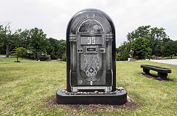 Aug. 06, 2017 - Cleveland, Ohio, U.S. -  The juke box replica headstone of disc jockey Alan Freed, known as ''the father of rock and roll,'' in Cleveland's Lake View Cemetery.  Also buried at Lake View are John D. Rockefeller Sr., G-Man Eliot Ness and cartoonist Harvey Pekar.(Credit Image: © Brian Cahn via ZUMA Wire)