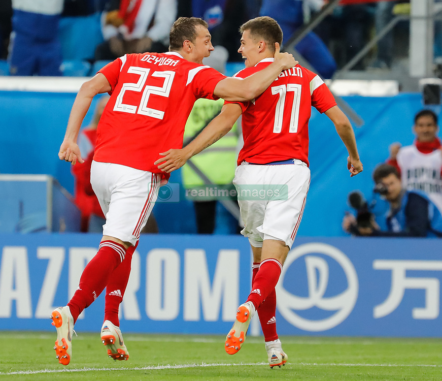 June 19, 2018 - Saint Petersburg, Russia - Artem Dzyuba (L) and Roman Zobnin of Russia national team celebrate a goal during the 2018 FIFA World Cup Russia group A match between Russia and Egypt on June 19, 2018 at Saint Petersburg Stadium in Saint Petersburg, Russia. (Credit Image: © Mike Kireev/NurPhoto via ZUMA Press)