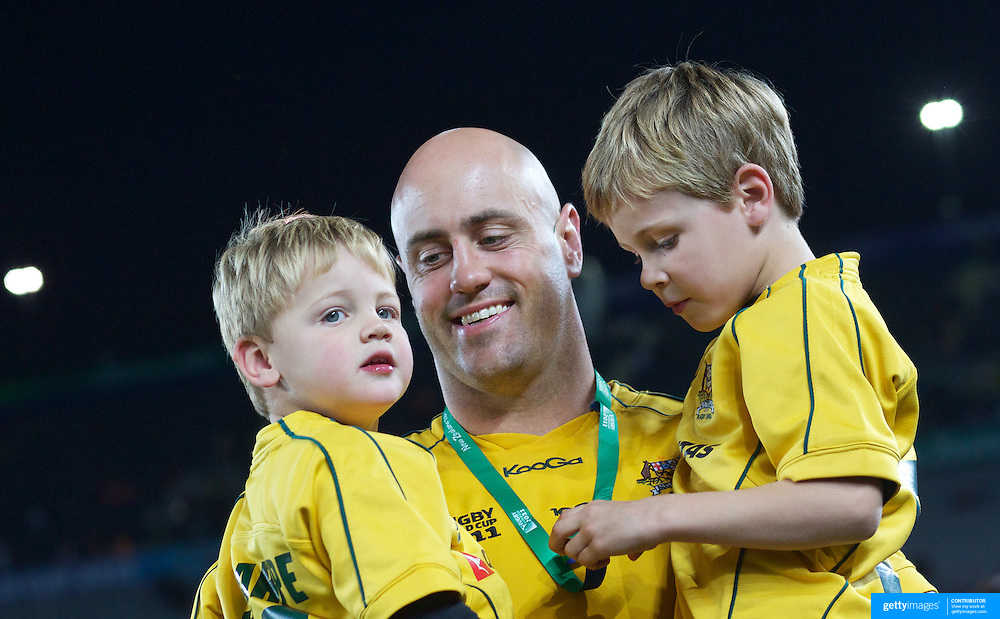Nathan Sharpe, Australia, with his children after playing his 100th test match during the Australia V Wales Bronze Final match at the IRB Rugby World Cup tournament, Auckland, New Zealand. 21st October 2011. Photo Tim Clayton...