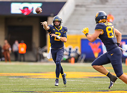 Oct 3, 2020; Morgantown, West Virginia, USA; West Virginia Mountaineers quarterback Jarret Doege (2) throws a pass to tight end Mike O'Laughlin (87) during the second overtime against the Baylor Bears at Mountaineer Field at Milan Puskar Stadium. Mandatory Credit: Ben Queen-USA TODAY Sports