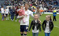 Preston North End's Joe Garner during his lap of the pitch after their last home league match of the season to applaud their fans for their support during the season<br /> <br /> Photographer Stephen White/CameraSport<br /> <br /> Football - The Football League Sky Bet League One - Preston North End v Swindon Town - Saturday 25th April 2015 - Deepdale - Preston<br /> <br /> © CameraSport - 43 Linden Ave. Countesthorpe. Leicester. England. LE8 5PG - Tel: +44 (0) 116 277 4147 - admin@camerasport.com - www.camerasport.com