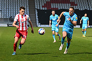 Stevenage midfielder Jack Smith(23)  and Cheltenham Town Defender Chris Hussey(3) battles for possession during the EFL Sky Bet League 2 match between Stevenage and Cheltenham Town at the Lamex Stadium, Stevenage, England on 20 April 2021.