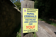 Gloucestershire Constabulary police sign to deter rural criminals near Slad, Gloucestershire, United Kingdom.