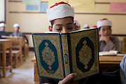 A schoolboy recites Arabic verses from the Koran in a classroom at the Islamic Koom al-Bourit Institute for Boys in the village of Qum (Koom), on the West Bank of Luxor, Nile Valley, Egypt.