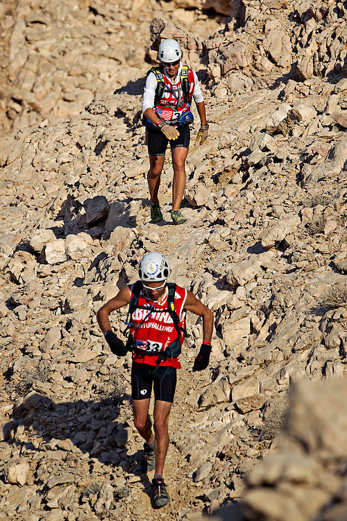 Yankee Scribes teammates Adam Chase (front) and Sheila Taormina (back) fight to find footing on the tricky terrain of Jebel Hafeet - Abu Dhabi's Highest Peak...4th Annual Abu Dhabi Adventure Challenge..December 10th through December 15th, 2010. ..The Abu Dhabi Adventure Challenge (ADAC) is a 6 Day staged endurance race consisting of disciplines such as mountain biking, trekking, canoeing, sea kayaking, abseiling, running, and swimming. Coed teams of 4 will attempt to tame this beast of a course through the beautiful Emirate of Abu Dhabi, UAE..Photo by Chris Radcliffe