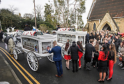 "© Licensed to London News Pictures. 14/02/2020. Sevenoaks, UK. Mourners gather around and touch the coffins as they leave St John the Baptist church in Sevenoaks, Kent following the funeral service of traveller brothers Billy and Joe Smith. The twin brothers, who were made famous by the television programme ""My Big Fat Gypsy Wedding"", were found hanged in woodland three days after Christmas. Photo credit: Ben Cawthra/LNP"