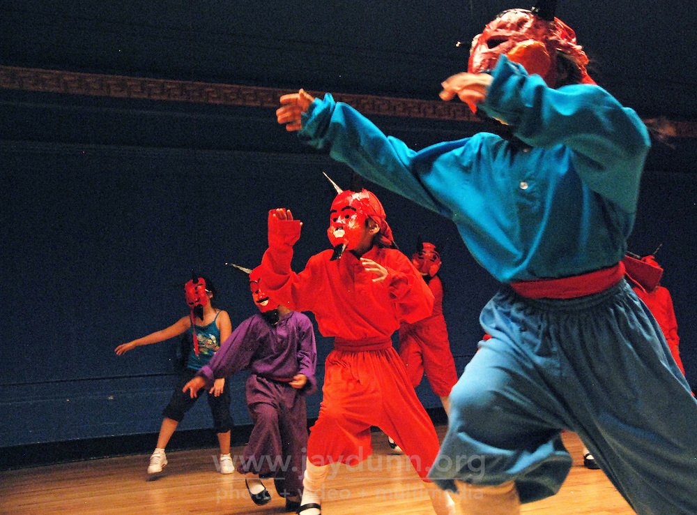 """USA, Chicago, July 2nd - 23rd, 2009.  For almost 20 years, Polo Garcia, a professional dance teacher from """"America Baila,"""" has been giving traditional South American dance lessons at various Pilsen and Little Village schools, including Maria Saucedo Scholastic Academy, whose turn-of-the-century auditorium is featured here. Garcia, who is Mexican, does the research for these dances in-person, makes the costumes himself, and provides free summer classes. He works with Claudio Rabadan, a former Saucedo student, and professional instructor Ruben Pachas from Peru. Photographs for HOY by Jay Dunn."""