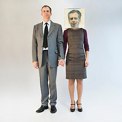 Businessman holding hands and standing near businesswoman wearing mask