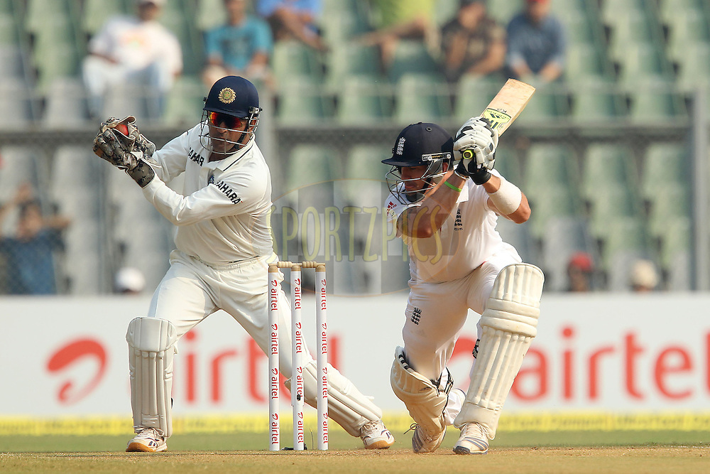 Kevin Pietersen of England mis times a delivery from Pragyan Ojha of India and Mahendra Singh Dhoni - Captain of India collects during day 3 of the 2nd Airtel Test match between India and England held at the Wankhede Stadium in Mumbai, India on the 25th November 2012...Photo by Ron Gaunt/ BCCI/ SPORTZPICS..Use of this image is subject to the terms and conditions as outlined by the BCCI. These terms can be found by following this link:..http://www.sportzpics.co.za/image/I0000SoRagM2cIEc