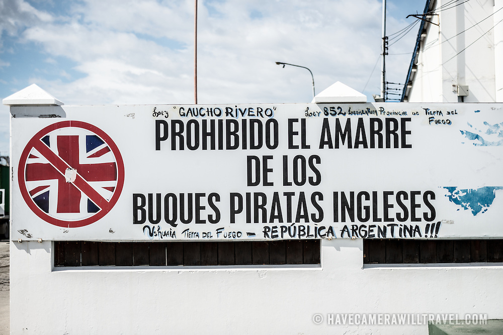"""An anti-British sign in Ushuaia Harbor warning against British """"pirates."""" The sentiment goes back to the 1982 conflict between Britain and Argentina over islands off Argentina's coast known in Britain as the Falkland Islands and in Argentina as the Malvinas Islands."""