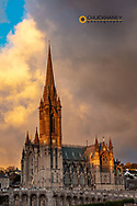 Sunset clouds over St Colmans Cathedral in Cobh, Ireland