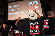 """7 AUG. 2018 -- ST. LOUIS -- Chet Bogus (right) and Jane Busby dance in celebration as results are announced during a post-election gathering of union members involved in the Vote No on Prop A campaign at Sheet Metal Workers Local 36 in St. Louis Tuesday, Aug. 7, 2018. The proposition, on the Aug. 7 primary ballot, would have added Missouri to the list of states with""""right to work"""" labor laws. Photo © copyright 2018 Sid Hastings."""
