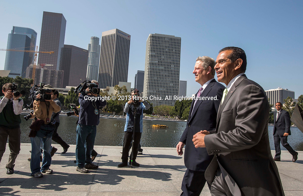 Former U.S. Vice President and Nobel laureate Al Gore, and Los Angeles Mayor Antonia Villaraigosa arrive in a press conference in front of the Los Angeles Department of Water building on Friday March 22, 2013, to announce Los Angeles plans to become the largest coal-free city in the country by shifting the Los Angeles Department of Water and Power off ?dirty? coal and replacing it with renewable energy sources and natural gas. LADWP currently gets 70 percent of its energy from coal plants. Gore included Los Angeles among the top five cities in the world ``where combating global warming is concerned.'' Only the cities of London, Toronto, Copenhagen and Berlin have ``tried to do something like this,'' he said, adding that Los Angeles would be the first American city to become coal-free.(Photo by Ringo Chiu/PHOTOFORMULA.com).