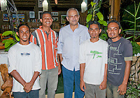 """President Jose Ramos-Horta of Timor-Leste (East Timor) (center) stands with biology students (left to right) Agivedo """"Laca"""" Ribeiro, Venancio """"Benny"""" Lopez Carvalho, Zito Afranio, and Luis Lemos at his home in Dili on February 4, 2010."""