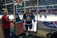 KELOWNA, CANADA, NOVEMBER 25: Carter Rigby #11 of the Kelowna Rockets exits the ice after warm up as the Kootenay Ice visit the Kelowna Rockets  on November 25, 2011 at Prospera Place in Kelowna, British Columbia, Canada (Photo by Marissa Baecker/Shoot the Breeze) *** Local Caption *** Carter Rigby;
