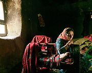 A women breastfeeding her newly born.  The traditional life of the Wakhi people, in the Wakhan corridor, amongst the Pamir mountains.