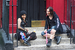 Portland Place, London, June 25th 2016. Thousands of LGBT people and their supporters gather for Pride in London, a colourful celebration of the hard-won rights of lesbian, gay, bisexual and transgender  people. PICTURED: Two friends relax in Soho.