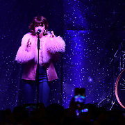 Singer Maisie Peters performs at Regent Street Christmas Lights switch-on celebrate its 200th anniversary on 14 November 2019, London, UK.