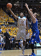 WICHITA, KS - JANUARY 18:  Guard Tekele Cotton #32 of the Wichita State Shockers drives in for a basket against the Indiana State Sycamores during the first half on January 18, 2014 at Charles Koch Arena in Wichita, Kansas.  (Photo by Peter Aiken/Getty Images) *** Local Caption *** Tekele Cotton