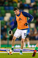 Northern Ireland forward Kyle Lafferty warms up before the UEFA European 2020 Qualifier match between Northern Ireland and Estonia at National Football Stadium, Windsor Park, Northern Ireland on 21 March 2019.
