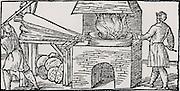 Using bellows to increase the draught in a furnace for refining copper. From 'De la pirotechnia' by Vannoccio Biriguccio (Venice, 1540).
