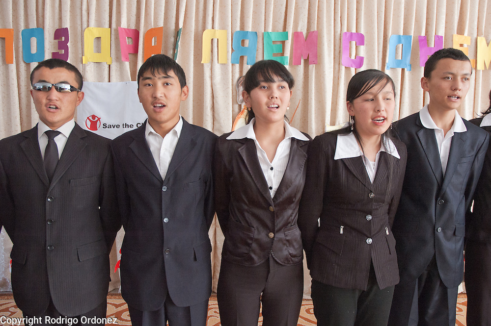 Boys and girls sing a song during the opening ceremony of a child-friendly space supported by Save the Children at Secondary School for the Blind, in Osh (Kyrgyzstan). At this boarding school, children with and without impaired vision study together.