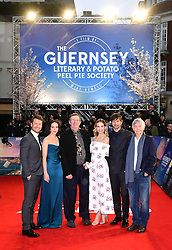Glen Powell (left to right), Jessica Brown Findlay, Mike Newell, Lily James, Michiel Huisman, Tom Courtney attending The Guernsey Literary and Potato Peel Pie Society world premiere held at Curzon Mayfair, London.