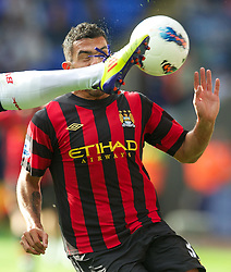 21.08.2011, Reebok Stadium, Bolton, ENG, PL, Bolton Wanderers FC vs Manchester City FC, im Bild Manchester City's Carlos Tevez gets a boot in the face in action against Bolton Wanderers during the Premiership match at the Reebok Stadium, EXPA Pictures © 2011, PhotoCredit: EXPA/ Propaganda/ D. Rawcliffe *** ATTENTION *** UK OUT!