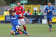 Charlton Athletic midfielder Jake Forster-Caskey (19) fouling AFC Wimbledon striker Lyle Taylor (33) during the The FA Cup match between AFC Wimbledon and Charlton Athletic at the Cherry Red Records Stadium, Kingston, England on 3 December 2017. Photo by Matthew Redman.