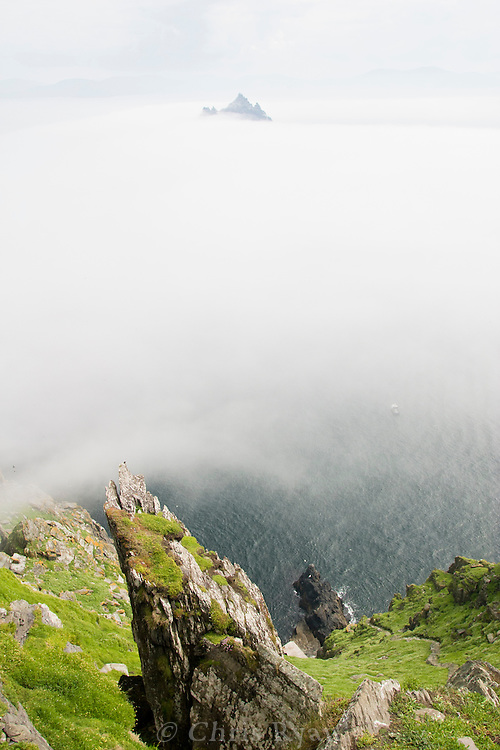 View from Skellig Michael; Little Skellig peaking through clouds in background; County Kerry, Ireland