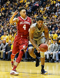 Jan 6, 2018; Morgantown, WV, USA; West Virginia Mountaineers forward Sagaba Konate (50) makes a move around Oklahoma Sooners center Jamuni McNeace (4) during the second half at WVU Coliseum. Mandatory Credit: Ben Queen-USA TODAY Sports