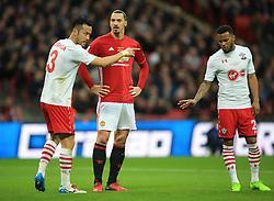 26 February 2017 - EFL Cup Final - Manchester United v Southampton - Zlatan Ibrahimovic of Manchester United flanked by Maya Yoshida and Ryan Bertrand of Southampton - Photo: Marc Atkins / Offside.
