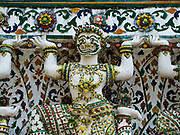 """11 SEPTEMBER 2017 - BANGKOK, THAILAND: Statues at Wat Arun. Renovations are nearly finished at Wat Arun on the Thonburi side of the Chao Phraya River in Bangkok. Wat Arun is famous for its Khmer style main """"prang"""" (chedi). It was originally built in the Ayutthaya Period and rebuilt to its current form in the time of Rama II.       PHOTO BY JACK KURTZ"""
