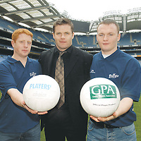 28 February 2007; The Gaelic Players Association and Club Energise announced its biggest annual scholarship scheme today. A total of 64 scholarships are being granted to third level students nationwide, making the GPA awards the largest GAA scheme of its kind in the country. These Scholarships are awarded using funds generated from the sale of Club Energise. At the announcement is Dessie Farrell, Chief Executive of the GPA, with Clare players, Jonathan Clancy, LIT, left, and David Reidy, NUI Galway. Croke Park, Dublin. Picture credit: Brian Lawless / SPORTSFILE *** NO REPRODUCTION FEE ***