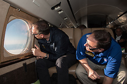Acting NASA administrator Robert Lightfoot, right, and NASA Associate Administrator for the Science Mission Directorate Thomas Zurbuchen view the solar eclipse Monday, August 21, 2017, from onboard a NASA Armstrong Flight Research Center's Gulfstream III 35,000 feet above the Oregon Coast. A total solar eclipse swept across a narrow portion of the contiguous United States from Lincoln Beach, Oregon to Charleston, South Carolina. Photo Credit: (NASA/Carla Thomas)