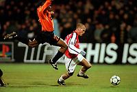 Fredrik Ljungberg (Arsenal) Isaac Okoronkwo (Shakhtar Donetsk). Shakhtar Donetsk 3:0 Arsenal, UEFA Champions League, Group B, Centralny Stadium, Donetsk, Ukraine, 7/11/2000. Credit Colorsport / Stuart MacFarlane.